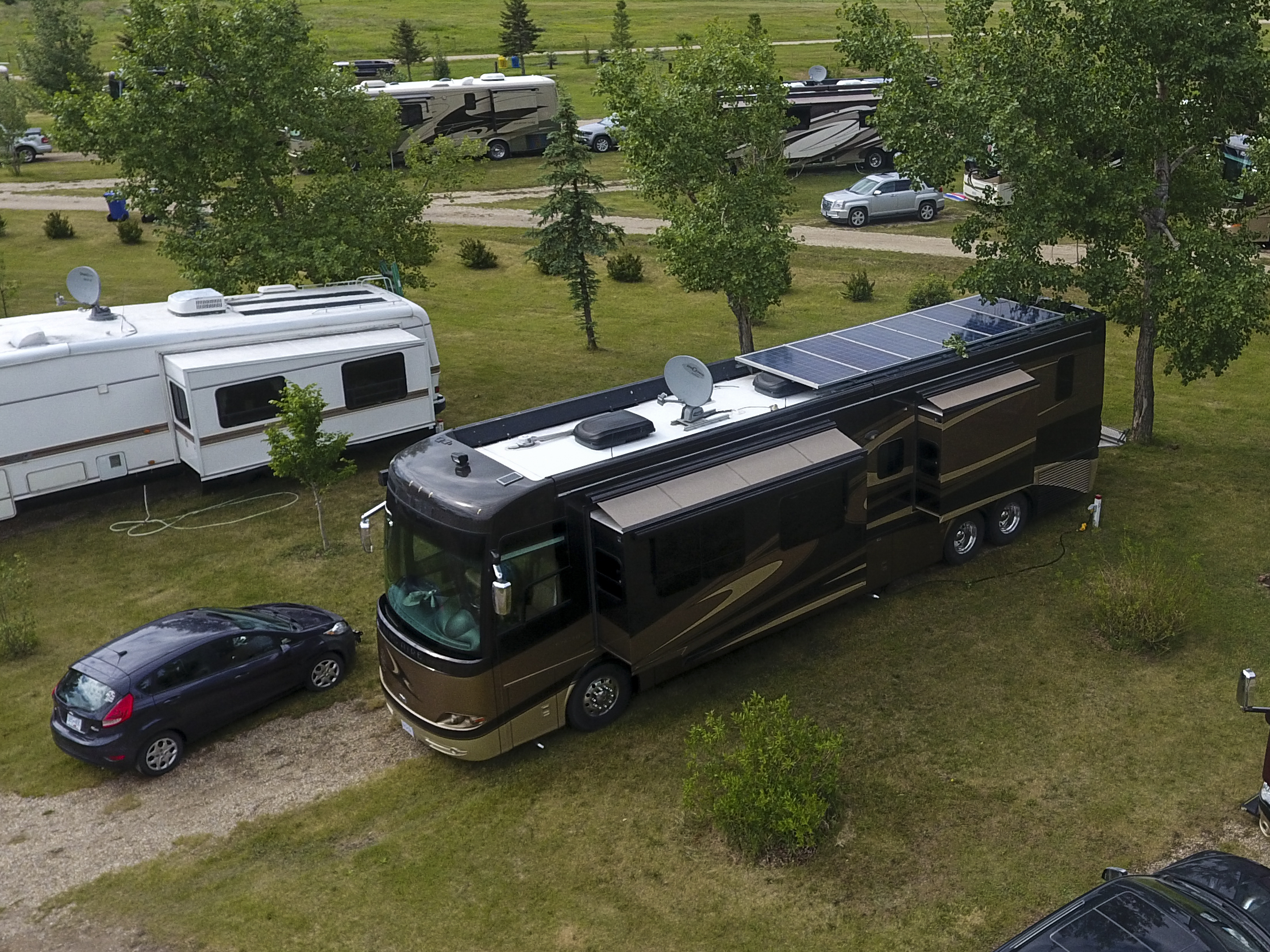 Six 305 Watt Solar Panels Installed On A King Aire. (That's A Newmar 5th Wheel On The Left.)